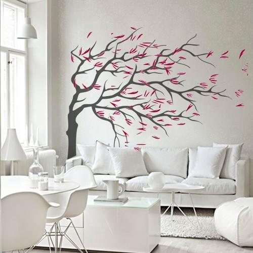 muursticker boom in de wind met gekleurde blaadjes