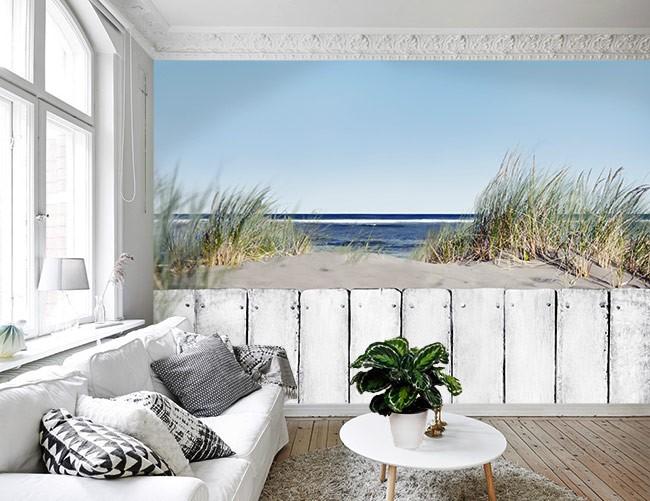 Vlies fotobehang Houten hek op strand : Muurmode.nl